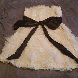 White ruffle dress with black ribbon